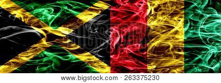 Jamaica Vs Guinea, Guinean Smoke Flags Placed Side By Side. Thick Colored Silky Smoke Flags Of Jamai