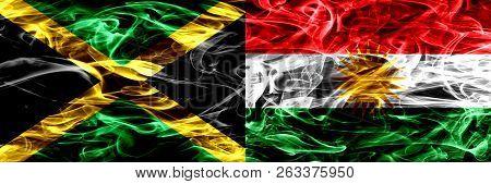 Jamaica Vs Kurdistan, Kurdish Smoke Flags Placed Side By Side. Thick Colored Silky Smoke Flags Of Ja