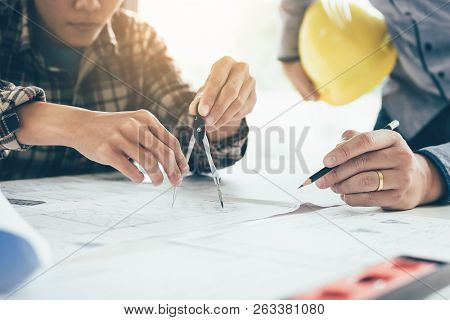 Architect People Working On Blueprint And Analysis With Partnership At Workplace.