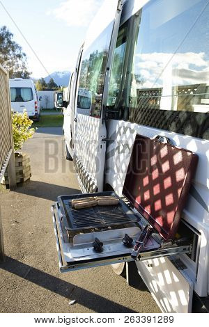 Using A Built In Barbeque On The Side Of A Campervan