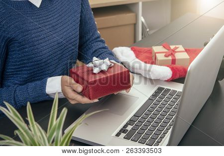 Business Woman Hand Holding Gift Box Working On Desk Office Concept Office Christmas And Happy New Y