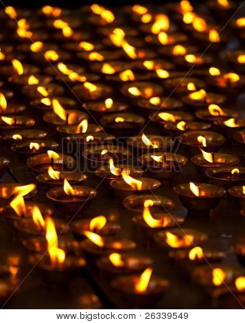 Burning candles in Buddhist temple. Tsuglagkhang complex,  McLeod Ganj, Himachal Pradesh, India Good for Diwali also