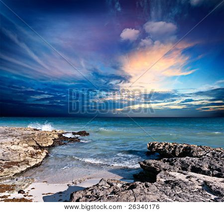Waves breaking against rocky coast