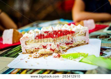 Cutting Children Birthday Cake At Kid Birthday Celebration.