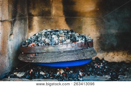 Cooking Of Traditional Balkan Greek Mediterranean Croatian Meal Peka Under Metal Lid.