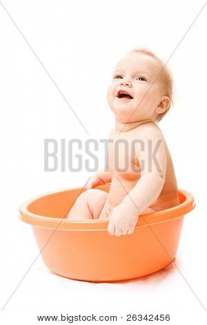 Cute baby having bath in tub. Isolated over white