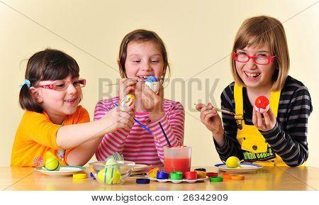 girls painting eggs