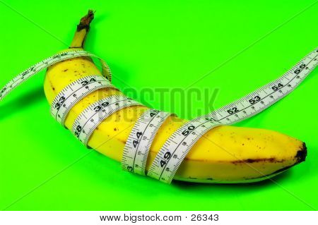 banana and tape measure on a green background poster