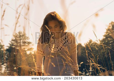 Beautiful Woman In Meadow. Young Beautiful Woman Walking In Meadow. Beautiful Woman Relaxing In Mead