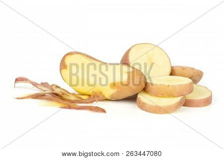 Group Of One Whole One Half Four Slices Of Fresh Red Potato Francelina Variety One Is Peeled Isolate