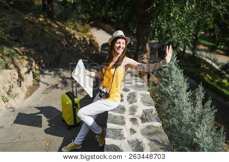 Pleasant Traveler Tourist Woman In Hat With Suitcase, City Map Waving Hand For Greeting, Meeting Fri