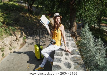 Young Traveler Tourist Woman In Yellow Clothes Hat With Suitcase City Map Looking Aside Sitting On S