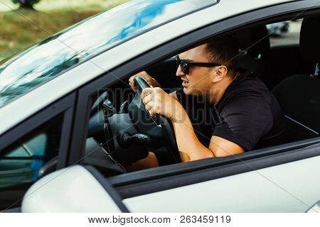 Scared Funny Looking Young Man Driver In The Car. Human Emotion Face Expression. Side Window View Of