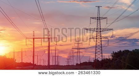 High Power Electricity Poles In Urban Area. Energy Supply, Distribution Of Energy, Transmitting Ener