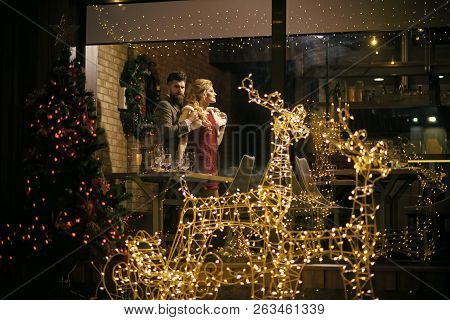 Happy Family Celebrate New Year And Christmas. Holidays Celebration Concept. Couple In Love Enjoy Xm