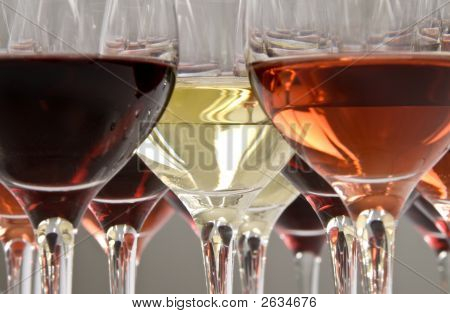 Three colors of wine: red pink and white ready for tasting. poster
