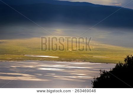 Scenic morning view of seasonal salt lake, Lake Magadi, also called Makat, center of Ngorongoro Crater Conservation Area in Tanzania, East Africa  poster