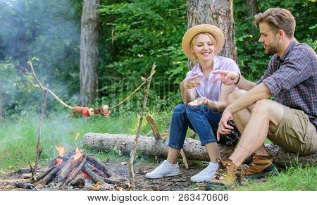Couple Play Rock Paper Scissors Hand Game. Couple Tourists Throwing Their Gesture While Sit Log Near