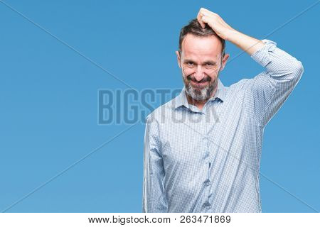 Middle age hoary senior business man over isolated background confuse and wonder about question. Uncertain with doubt, thinking with hand on head. Pensive concept.