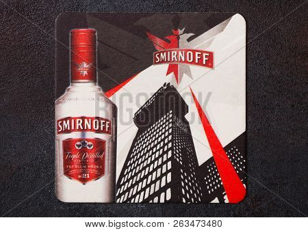 London, Uk - August 22, 2018: Smirnoff Vodka Original Mat Coaster On Black Stone Background.