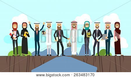 Arabic Businessman Shaking Hands In Business And Traditional Clothes Over Chasm Between Mountains, F