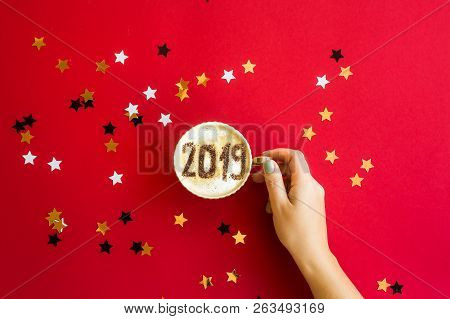 New Year 2019 Is Written On A Cup Of Coffee With Milk. The Concept Of The New Year On January 1. On