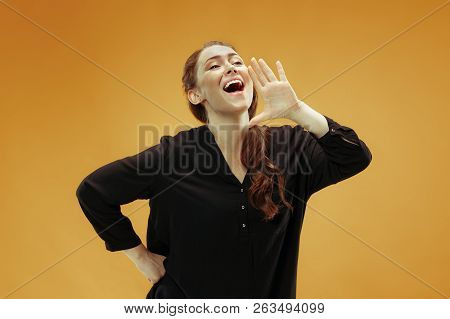 Do Not Miss. Young Casual Woman Shouting. Shout. Crying Emotional Woman Screaming On Orange Studio B