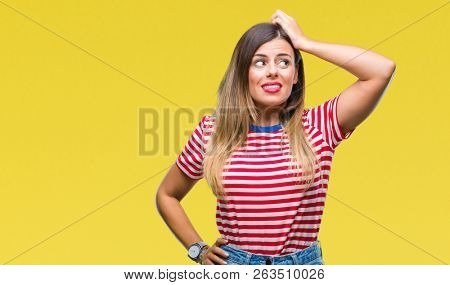 Young beautiful woman casual look over isolated background confuse and wonder about question. Uncertain with doubt, thinking with hand on head. Pensive concept.
