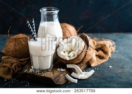 Fresh Coconut Milk In Glass And Bottle, Vegan Non Dairy Healthy Drink