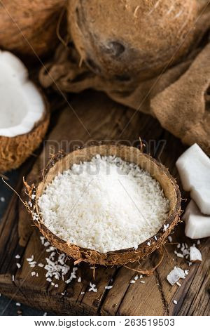 Coconut Flakes In Bowl On Table Closeup