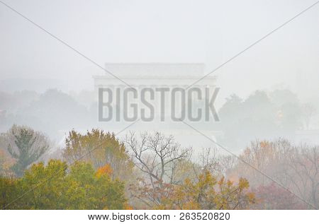 Washington DC in fog - Lincoln Memorial with heavy fog in autumn colors gives misty atmosphere to the Nation's Capital - Washington DC United States of America (USA)