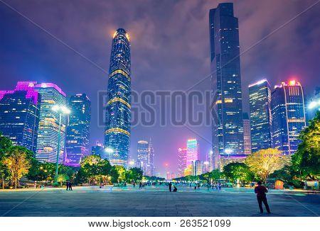 GUANGZHOU, CHINA - APRIL 27, 2018: Guangzhou cityscape skyline over the Pearl River illuminated in the evening. Guangzhou, China