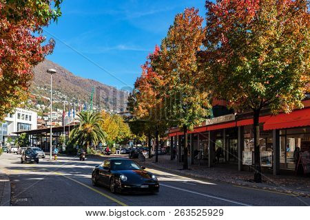 LOCARNO, SWITZERLAND - OCTOBER 29, 2016: Central street of Locarno in autumn - southern Swiss town in canton of Ticino, known for its International Film Festival taking place every year in August.