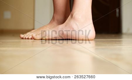 close-up of foot with flat feet, copy space poster