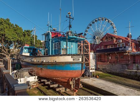 Cape Town, South Africa, August 9, 2018: A Boat On Dry Ground At The Victoria And Alfred Waterfront