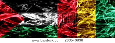 Palestine Vs Guinea, Guinean Smoke Flags Placed Side By Side. Thick Colored Silky Smoke Flags Of Pal