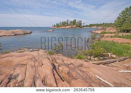 Worn Granite Rocks on a Wilderness Lakeshore on Lake Huron in Killarney Provincial Park in Ontario poster