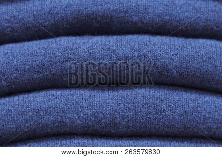 Stack Of Trend Sargasso Sea Woolen Sweaters Close-up, Texture, Background