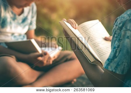 Men And Women Read Book In Quiet Nature, Concept Read A Book.