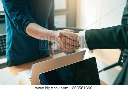 Business People Shaking Hands During A Meeting At Office Room.