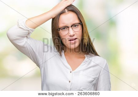 Young caucasian beautiful business woman wearing glasses over isolated background confuse and wonder about question. Uncertain with doubt, thinking with hand on head. Pensive concept.