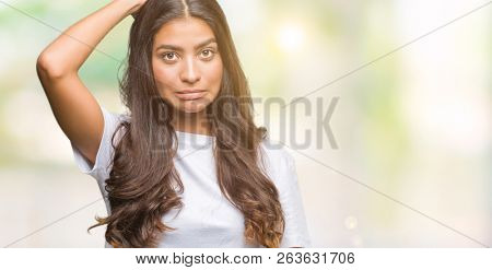 Young beautiful arab woman over isolated background confuse and wonder about question. Uncertain with doubt, thinking with hand on head. Pensive concept.