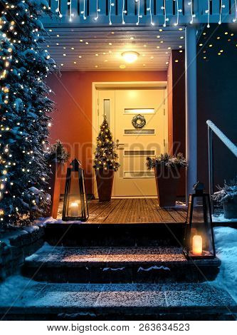Welcome Christmas - House Entrance Snowy Steps And Door With Decoration And Festive Lights
