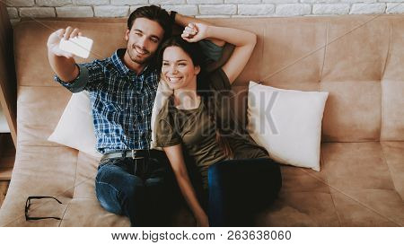 Man And Woman Make Selfie. Man And Woman Resting. Man Resting In Sofa. Woman Resting Home. Family In