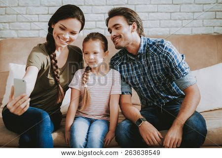 Family Makes Selfie. Smiling Little Girl. Smiling Family At Home. Smiling Person. Family With Child.