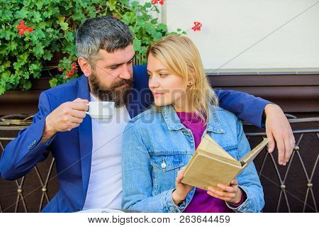 Love And Flirt. Common Interests. Couple In Love Sit Cafe Terrace. Man With Beard And Blonde Woman C