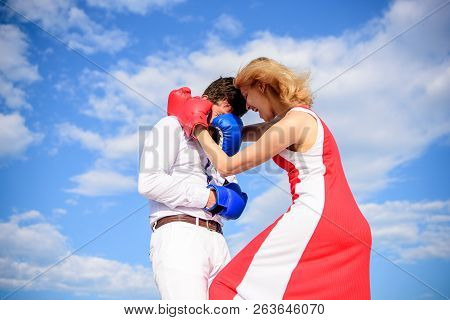 Man And Woman Boxing Gloves Fight Sky Background. She Knows How To Defend Herself. Girl Confident In