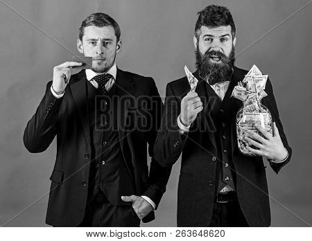 Loan And Banking Concept. Men In Suit, Businessmen With Jar Full Of Cash And Credit Card, Turquoise