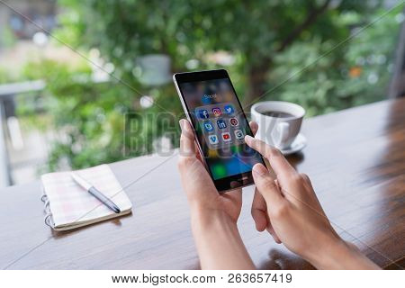 Chiang Mai, Thailand - August 18,2018: Woman Holding Huawei With Icons Of Social Media On The Screen