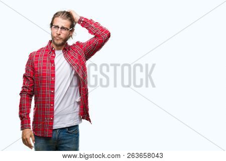 Young handsome man with long hair wearing glasses over isolated background confuse and wonder about question. Uncertain with doubt, thinking with hand on head. Pensive concept.